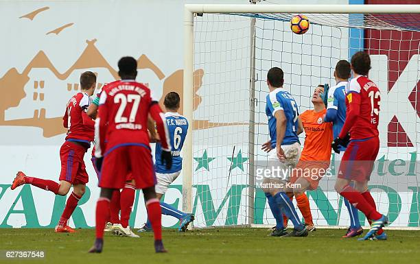 Dominick Drexler of Kiel scores the fourth goal during the third league match between FC Hansa Rostock and Holstein Kiel at Ostseestadion on December...