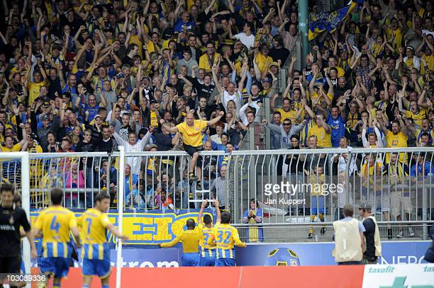 Dominick Kumbela celebrates his team's first goal with supporters during the third Liga match between Eintracht Braunschweig and Dynamo Dresden on...