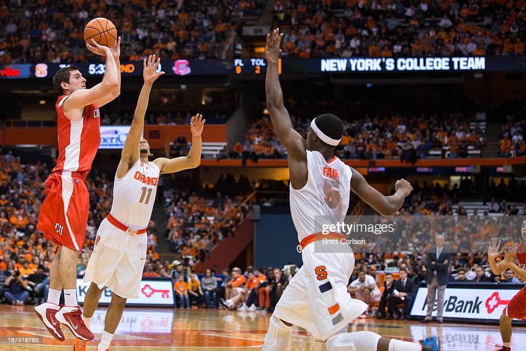 Dominick Scelfo #12 of Cornell Big Red shoots a three point shot against Syracuse Orange on November 8, 2013 at the Carrier Dome in Syracuse, New York.