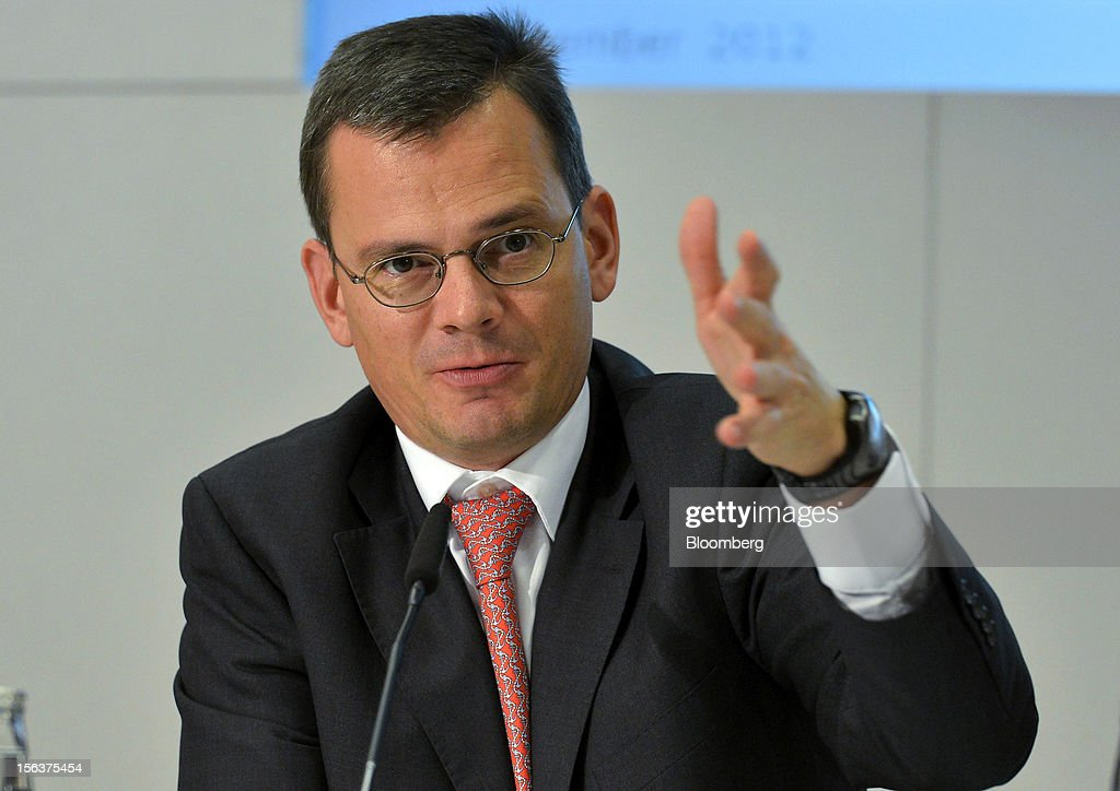 Dominik Asam, chief financial officer of Infineon Technologies AG, gestures as he speaks during the company's earnings news conference in Munich, Germany, on Wednesday, Nov. 14, 2012. Infineon Technologies AG, Europe's second-biggest semiconductor maker, reported fourth-quarter revenue that declined less than analysts expected and forecast sales to drop next year. Photographer: Guenter Schiffmann/Bloomberg via Getty Images