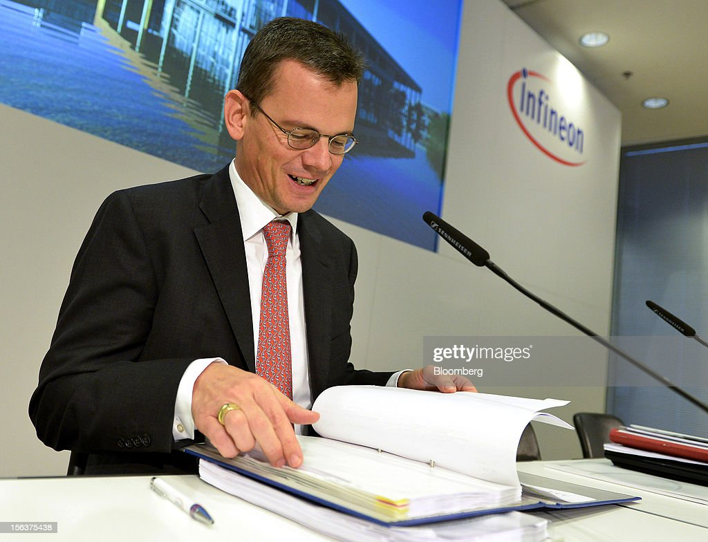 Dominik Asam, chief financial officer of Infineon Technologies AG, checks his paperwork ahead of the company's earnings news conference in Munich, Germany, on Wednesday, Nov. 14, 2012. Infineon Technologies AG, Europe's second-biggest semiconductor maker, reported fourth-quarter revenue that declined less than analysts expected and forecast sales to drop next year. Photographer: Guenter Schiffmann/Bloomberg via Getty Images