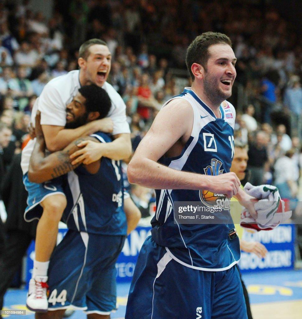 Dominik Bahiense de Mello Greg Jenkins and Dragan Labovic of Frankfurt celebrate after winning the Beko Basketball Bundesliga playoff match between...