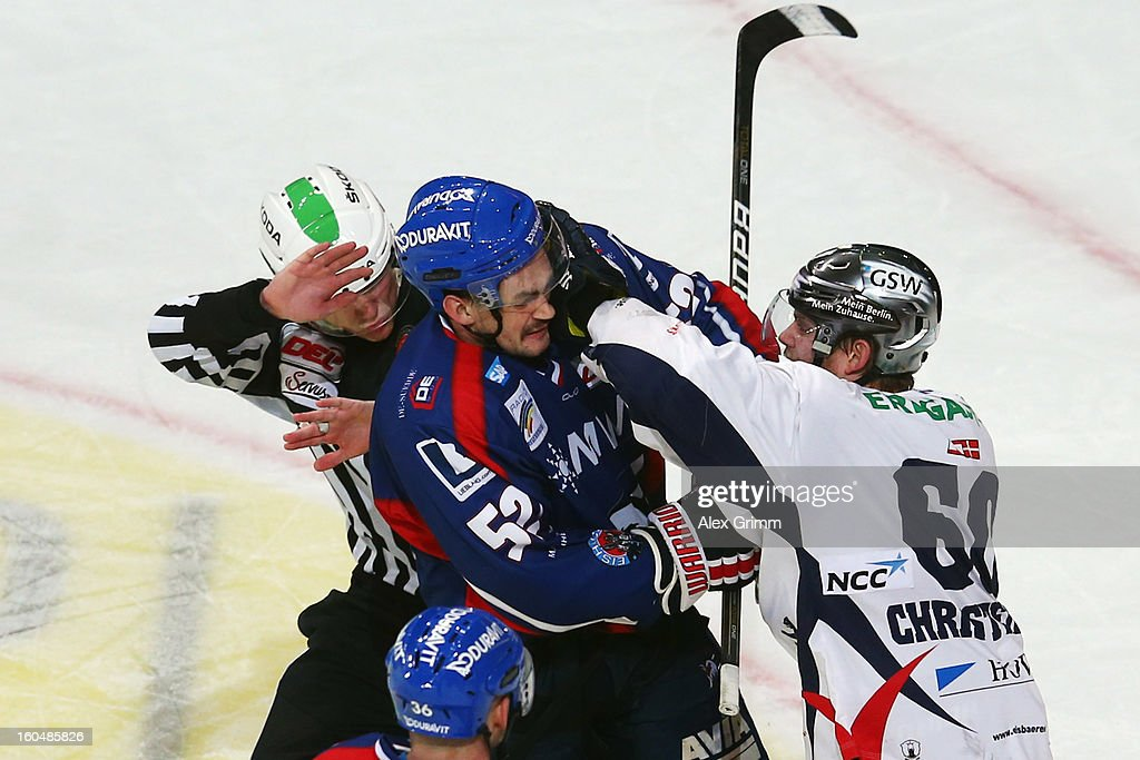 Dominik Bittner (L) of Mannheim and Mads Christensen of Berlin fight during the DEL match between Adler Mannheim and Eisbaeren Berlin at SAP Arena on February 1, 2013 in Mannheim, Germany.