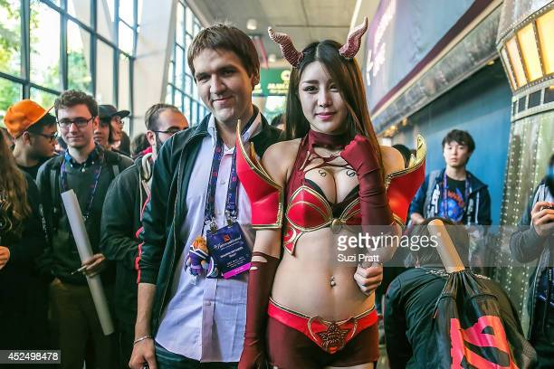 Dominik 'Black ^' Reitmeier poses with a fan at The International DOTA 2 Championships at Key Arena on July 21 2014 in Seattle Washington