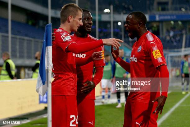 Dominik Drexler of Kiel celebrates the second goal with Kingsley Schindler and David Kinsombi during the Second Bundesliga match between MSV Duisburg...