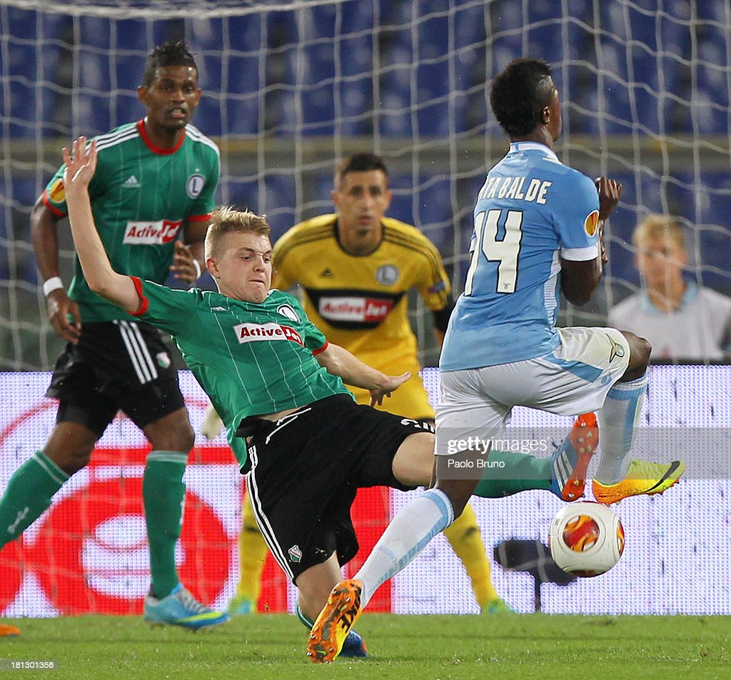 Dominik Furman of Legia Warszawa competes for the ball with Keita Balde of SS lazio during the Uefa Europa League Group J match between SS Lazio and Legia Warszawa at Stadio Olimpico on September 19, 2013 in Rome, Italy.