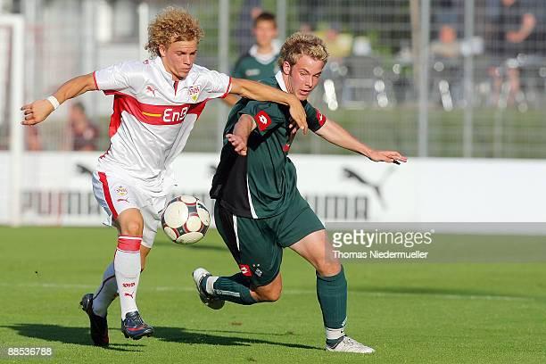 Dominik Gallert of Stuttgart fights for the ball with Patrick Herpe of Gladbach during the B juniors match between VfB Stuttgart and Borussia...