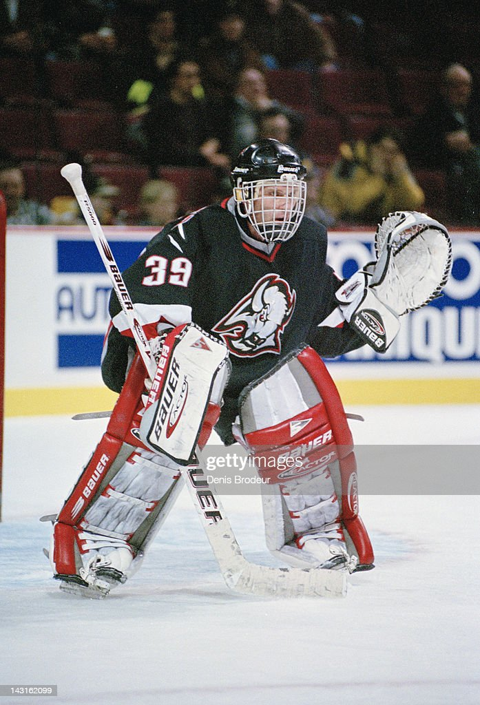 Dominik Hasek of the Buffalo Sabres follows the action Circa 1996 at the Montreal Forum in Montreal Quebec Canada