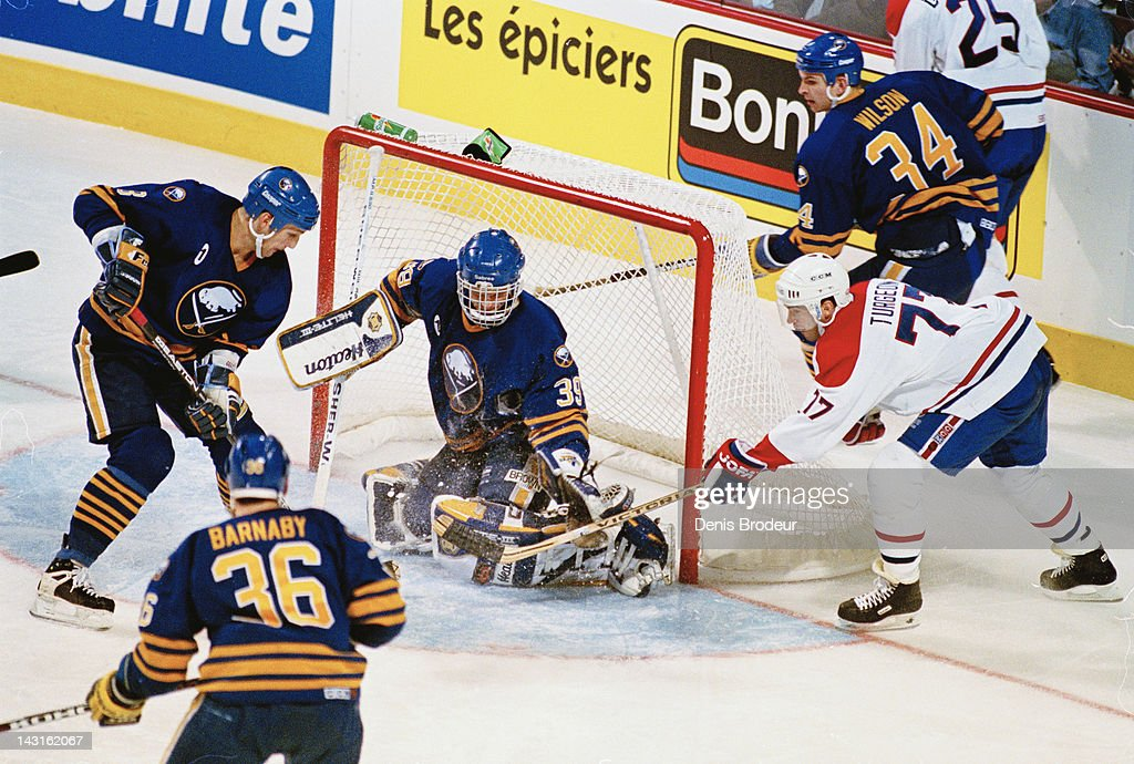 Dominik Hasek of the Buffalo Sabres saves a shot from Pierre Turgeon of the Montreal Canadiens Circa 1995 at the Montreal Forum in Montreal Quebec...