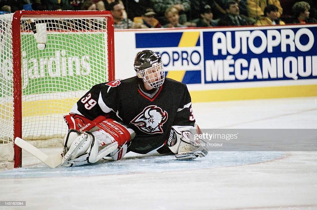 Dominik Hasek of the Buffalo Sabres stretches before a game against the Montreal Canadiens Circa 1996 at the Montreal Forum in Montreal Quebec Canada