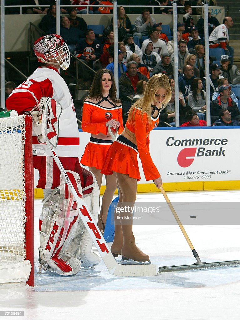 Dominik Hasek #39 of the Detroit Red Wings looks on as the Islanders ice girls tend to the ice during a TV timeout against the New York Islanders on January 30, 2007 at Nassau Coliseum in Uniondale, New York.