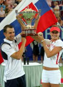 Dominik Hrbaty and Daniela Hantuchova of the Slovakia pose after winning the 2005 Hopman Cup at the Burswood Dome on January 8 2005 in Perth Australia