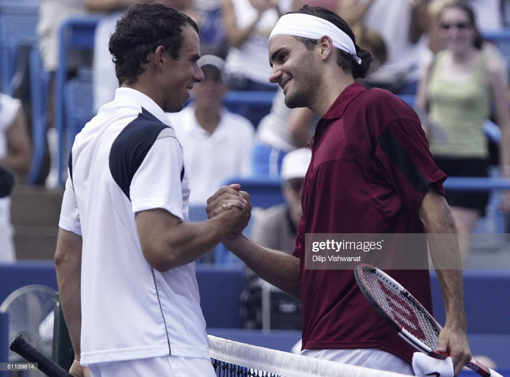 Dominik Hrbaty of Slovakia is congratulated by Roger Federer of Switzerland after Hrbaty beat Federer during the Western and Southern Financial Group...