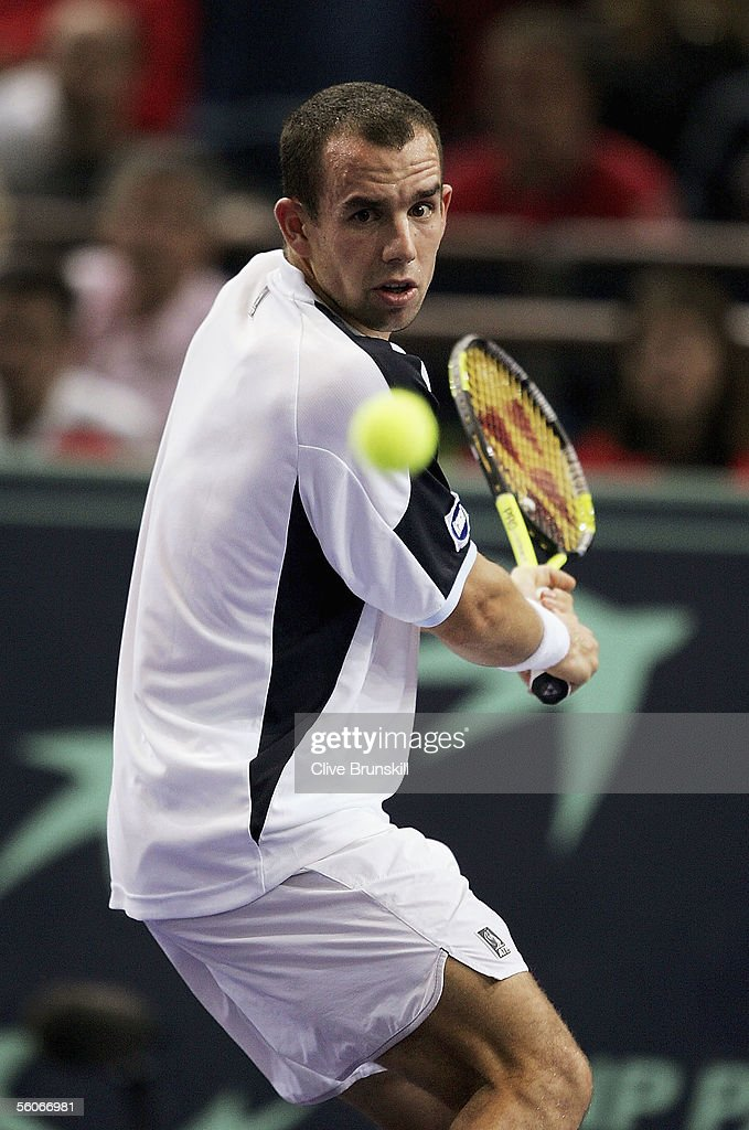 Dominik Hrbaty of Slovakia plays a backhand against Andy Roddick of the USA in his third round matchduring the BNP Paribas ATP Masters Series at the...
