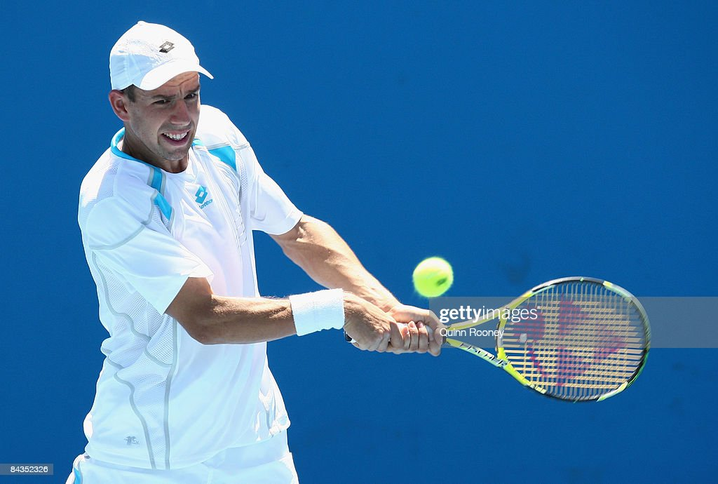 Dominik Hrbaty of Slovakia plays a backhand in his first round match against John Isner of the United States of America during day one of the 2009 Australian Open at Melbourne Park on January 19, 2009 in Melbourne, Australia.