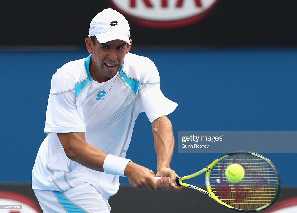 Dominik Hrbaty of Slovakia plays a backhand in his second round match against David Ferrer of Spain during day three of the 2009 Australian Open at Melbourne Park on January 21, 2009 in Melbourne, Australia.