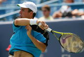 Dominik Hrbaty of Slovakia returns to Ivan Ljubicic of Croatia at the 2006 Western Southern Financial Group Masters on August 17 2006 at the Lindner...