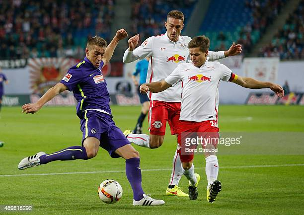 Dominik Kaiser and Stefan Ilsanker of Leipzig challenges Nils Petersen of Freiburg during the Second Bundesliga match between RB Leipzig and SC...