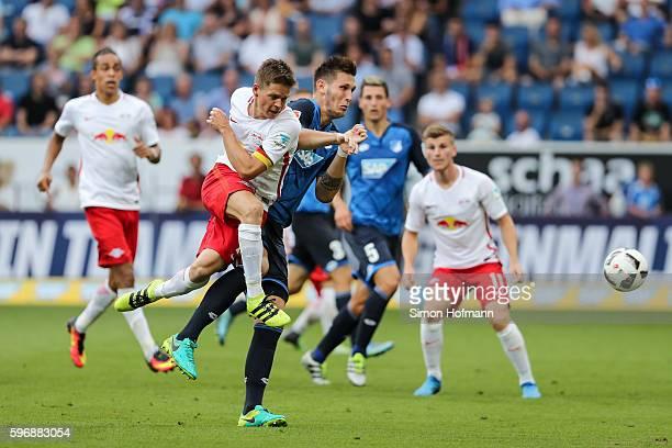 Dominik Kaiser of Leipzig scores his team's first goal against Niklas Suele of Hoffenheim during the Bundesliga match between TSG 1899 Hoffenheim and...