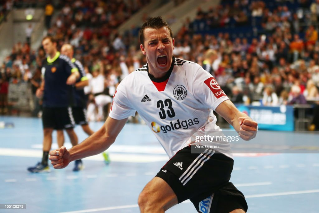 <a gi-track='captionPersonalityLinkClicked' href=/galleries/search?phrase=Dominik+Klein&family=editorial&specificpeople=579023 ng-click='$event.stopPropagation()'>Dominik Klein</a> of Germany celebrates a goal during the EHF Euro 2014 qualifying match between Germany and Montenegro at SAP Arena on November 1, 2012 in Mannheim, Germany.