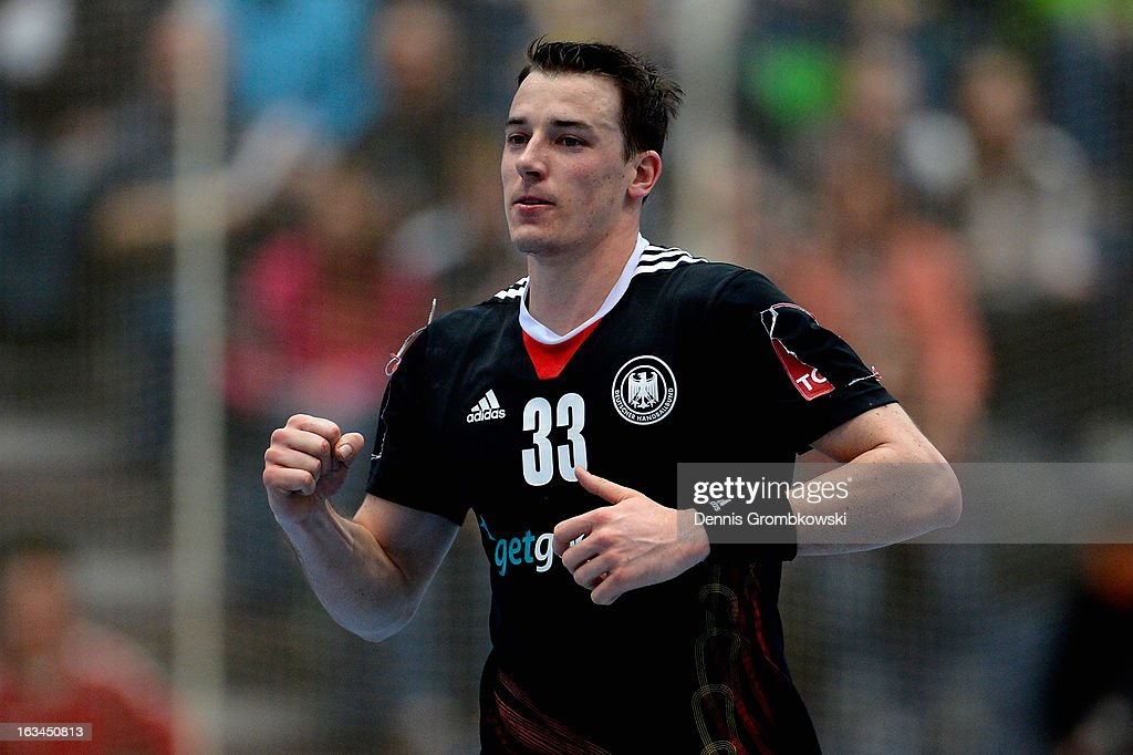 <a gi-track='captionPersonalityLinkClicked' href=/galleries/search?phrase=Dominik+Klein&family=editorial&specificpeople=579023 ng-click='$event.stopPropagation()'>Dominik Klein</a> of Germany celebrates during the DHB International Friendly match between Germany and Switzerland at Conlog-Arena on March 10, 2013 in Koblenz am Rhein, Germany.