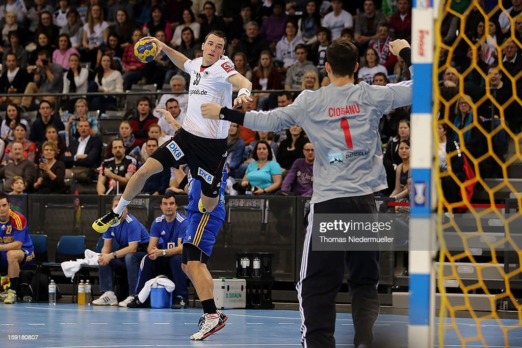 <a gi-track='captionPersonalityLinkClicked' href=/galleries/search?phrase=Dominik+Klein&family=editorial&specificpeople=579023 ng-click='$event.stopPropagation()'>Dominik Klein</a> of Germany throws the ball during the handball international friendly match between Germany and Romania at Porsche-Arena on January 09, 2013 in Stuttgart, Germany.