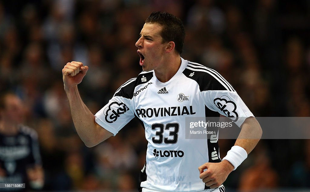 <a gi-track='captionPersonalityLinkClicked' href=/galleries/search?phrase=Dominik+Klein&family=editorial&specificpeople=579023 ng-click='$event.stopPropagation()'>Dominik Klein</a> of Kiel celebrates after scoring during the DKB Handball Bundesliga match between THW Kiel and SG Flensburg-Handewitt at Sparkassen Arena on November 7, 2012 in Kiel, Germany.