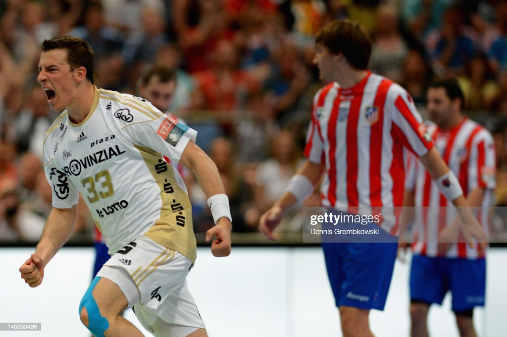 Dominik Klein of Kiel celebrates after scoring during the EHF Final Four final match between THW Kiel and BM Atletico Madrid at Lanxess Arena on May 27, 2012 in Cologne, Germany.
