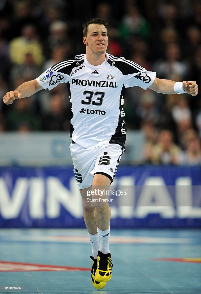 <a gi-track='captionPersonalityLinkClicked' href=/galleries/search?phrase=Dominik+Klein&family=editorial&specificpeople=579023 ng-click='$event.stopPropagation()'>Dominik Klein</a> of Kiel celebrates during the HBL Bundesliga game between THW Kiel and TSV Hannover-Burgdorf at the Sparkassen arena on February 13, 2013 in Kiel, Germany.