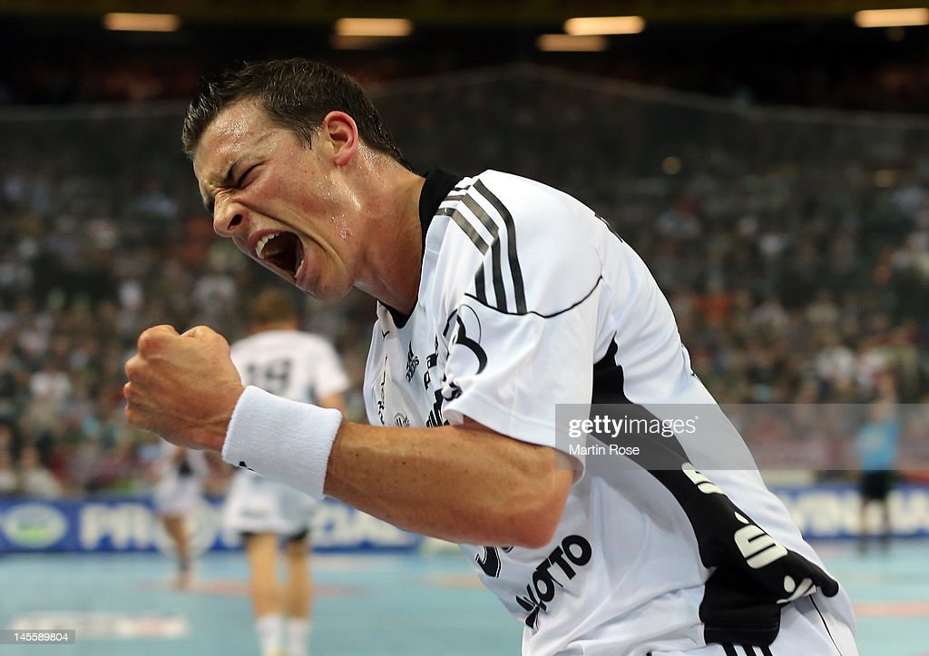 <a gi-track='captionPersonalityLinkClicked' href=/galleries/search?phrase=Dominik+Klein&family=editorial&specificpeople=579023 ng-click='$event.stopPropagation()'>Dominik Klein</a> of Kiel celebrates during the Toyota Handball Bundesliga match between THW Kiel and VfL Gummersbach at Sparkassen Arena on June 2, 2012 in Kiel, Germany.