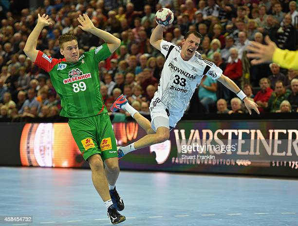 Dominik Klein of Kiel challenges for the ball with Espen Lie Hansen of Magdeburg during the DKB Bundesliga handball match between THW Kiel and SC...