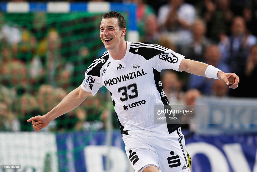 <a gi-track='captionPersonalityLinkClicked' href=/galleries/search?phrase=Dominik+Klein&family=editorial&specificpeople=579023 ng-click='$event.stopPropagation()'>Dominik Klein</a> of Kiel is celebrates during the DKB Handball Bundesliga match between THW Kiel and Fuechse Berlin at Sparkassen-Arena on May 14, 2013 in Kiel, Germany.