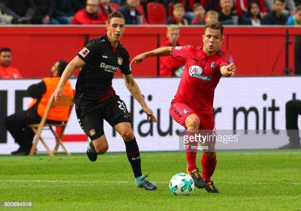 Dominik Kohr and Amir Abrashibattle for the ball during the Bundesliga match between Bayer 04 Leverkusen and SC Freiburg at BayArena on September 17...