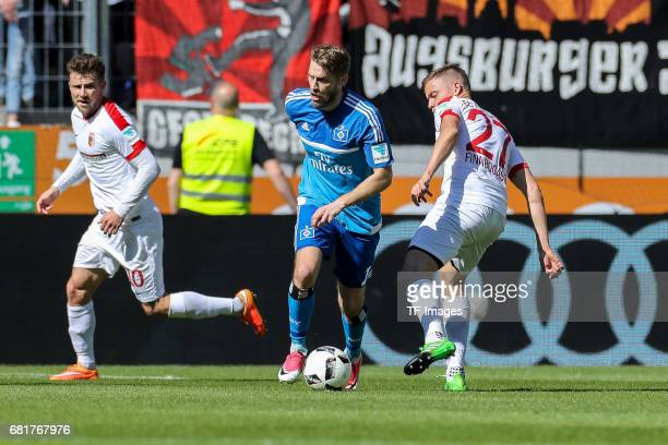 Dominik Kohr of Augsburg and Aaron Hunt of Hamburg battle for the ball during the Bundesliga match between FC Augsburg and Hamburger SV at WWK Arena...