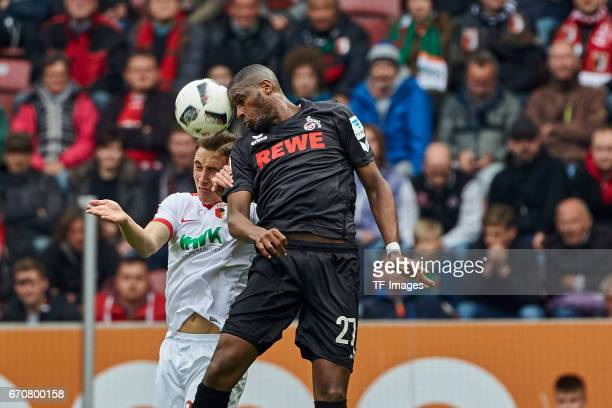 Dominik Kohr of Augsburg and Anthony Modeste't of Colonge battle for the ball during the Bundesliga match between FC Augsburg and 1 FC Koeln at WWK...