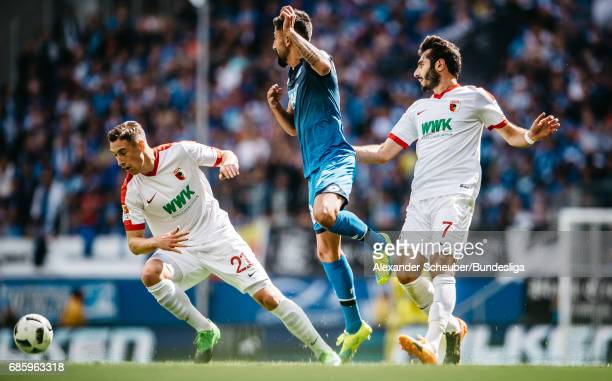 Dominik Kohr of Augsburg and Halil Altintop of Augsburg challenges Kerem Demirbay of Hoffenheim during the Bundesliga match between TSG 1899...