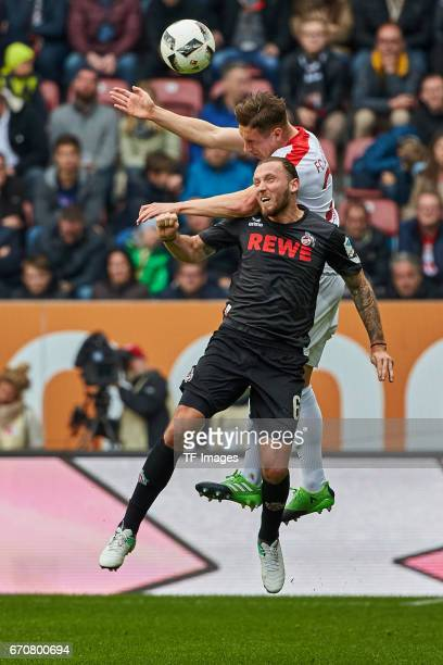 Dominik Kohr of Augsburg and Marco Hoeger of Colonge battle for the ball during the Bundesliga match between FC Augsburg and 1 FC Koeln at WWK Arena...