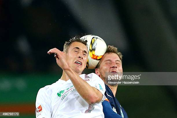 Dominik Kohr of Augsburg battles for the ball with Philipp Bargfrede of Bremen during the Bundesliga match between FC Augsburg and SV Werder Bremen...