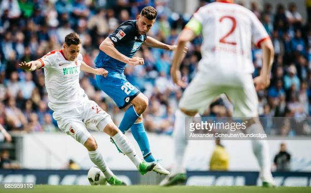 Dominik Kohr of Augsburg challenges Adam Szalai of Hoffenheim during the Bundesliga match between TSG 1899 Hoffenheim and FC Augsburg at Wirsol...
