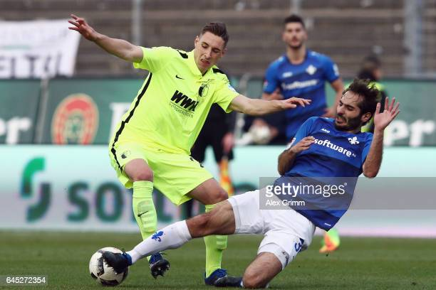 Dominik Kohr of Augsburg is challenged by Hamit Altintop of Darmstadt during the Bundesliga match between SV Darmstadt 98 and FC Augsburg at...