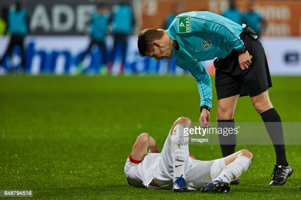 Dominik Kohr of Augsburg on the ground during the Bundesliga match between FC Augsburg and RB Leipzig at WWK Arena on March 3 2017 in Augsburg Germany