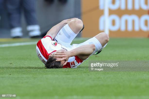 Dominik Kohr of Augsburg on the ground during the Bundesliga match between FC Augsburg and Hamburger SV at WWK Arena on April 30 2017 in Augsburg...
