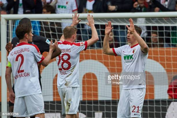 Dominik Kohr of Augsburg shakes hands with Georg Teigl of Augsburg during the Bundesliga match between FC Augsburg and 1 FC Koeln at WWK Arena on...