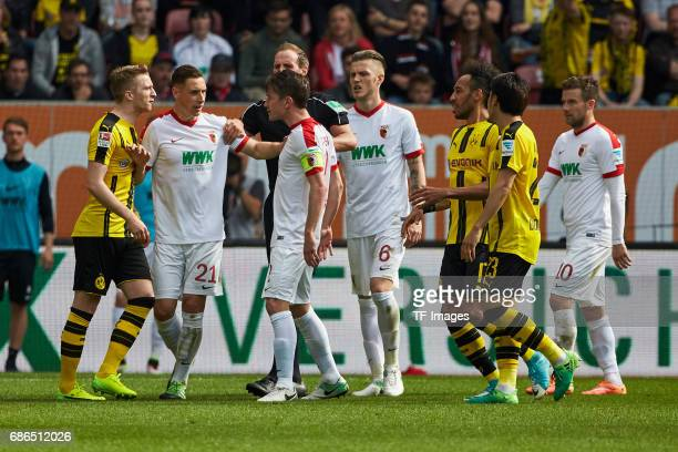 Dominik Kohr of Augsburg Speak with Marco Reus of Dortmund during the Bundesliga match between FC Augsburg and Borussia Dortmund at the WWKArena on...