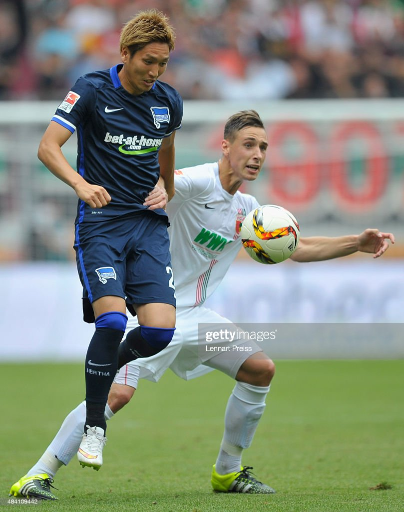 Dominik Kohr (R) of FC Augsburg challenges Genki Haraguchi of Hertha BSC during the Bundesliga match between FC Augsburg and Hertha BSC at WWK-Arena on August 15, 2015 in Augsburg, Germany.