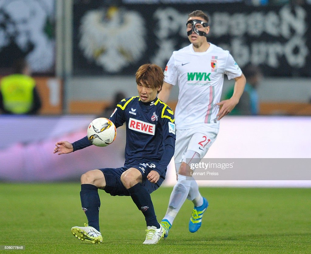 Dominik Kohr (R) of FC Augsburg challenges Yuya Osako of 1. FC Koeln during the Bundesliga match between FC Augsburg and 1. FC Koeln at WWK Arena on April 29, 2016 in Augsburg, Germany.
