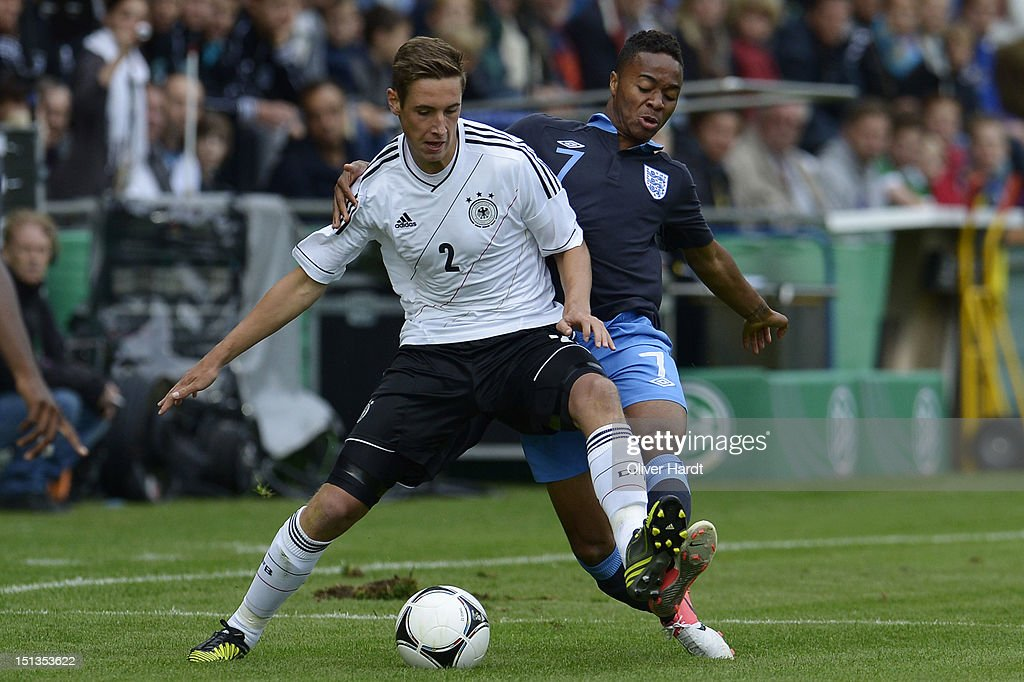 Dominik Kohr (L) of Germany and <a gi-track='captionPersonalityLinkClicked' href=/galleries/search?phrase=Raheem+Sterling&family=editorial&specificpeople=6489439 ng-click='$event.stopPropagation()'>Raheem Sterling</a> (R) of England battle for the ball during the Under 19 international friendly match between Germany and England at Stadion an der Lohmuehle on September 6, 2012 in Luebeck, Germany.