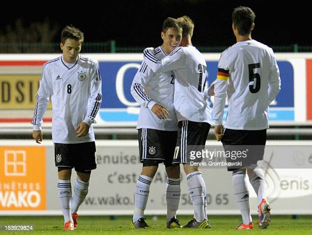 Dominik Kohr of Germany celebrates with teammates after scoring during the Under 19 EURO qualification match between U19 Macedonia and U19 Germany on...