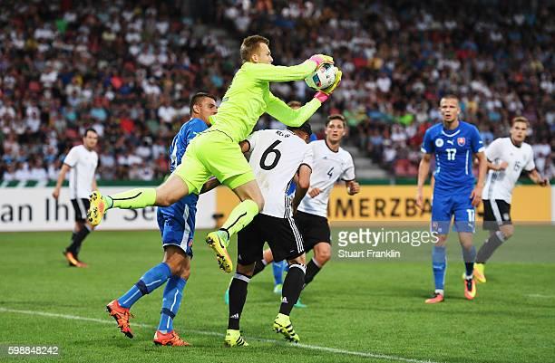 Dominik Kohr of Germany is challenged by Marek Rodak of Slovakia during the Under21 friendly match between U21 Germany and U21 Slovakia at Auestadion...