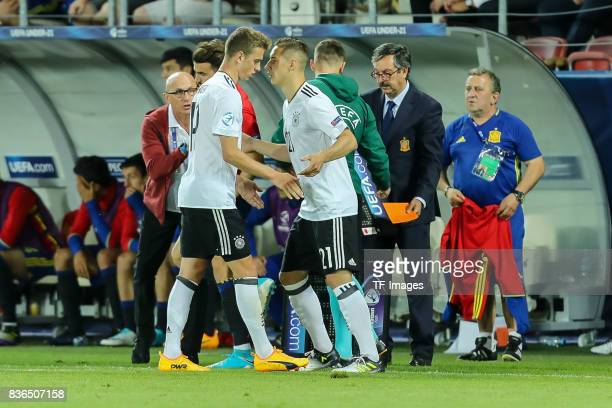 Dominik Kohr of Germany shakes hands with Janik Haberer of Germany during the UEFA U21 Final match between Germany and Spain at Krakow Stadium on...
